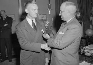 "28 Mar 1949, Washington, DC, USA --- Surprise Decoration for Forrestal.  Washington, D.C.:  Retiring Secretary of Defense James V. Forrestal is shown as he received distinguished service medal from President Harry S. Truman in surprise ceremony in White House.  Forrestal's resignation became effective today, and the citation with medal haled his ""exceptionally meritorious service in duty of great responsibility.""  New secretary of defense is Louis A. Johnson. --- Image by © Bettmann/CORBIS"